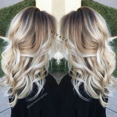 Blonde cool tones. Dark base icy ends with balayage highlights