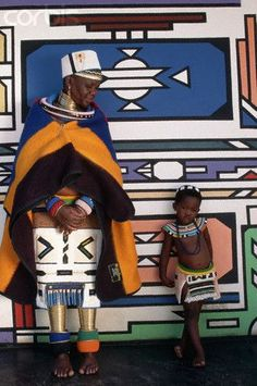 Ndebele mother and daughter standing next to their traditionally painted house / Africa-© Lindsay Hebberd / Corbis. African Tribes, African Women, African Art, We Are The World, People Of The World, African Beauty, African Fashion, Art Tribal, Ethno Style
