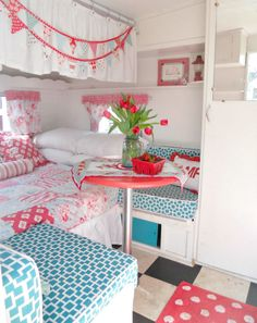 OMG I want to live here! love that bed area and the curtain over it.. and the cute little table and cushions.