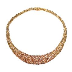 Gold and Colored Diamond Necklace The graduated design set with variously-shaped diamonds of yellow and brown hue, internal circumference 15½ inches.