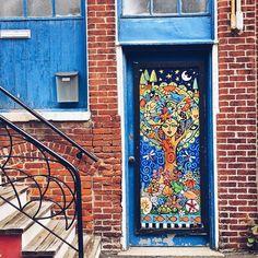 Back alley door art.
