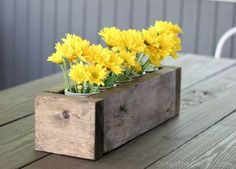 Fresh flowers in a rustic looking box make a great John Deere birthday centerpiece. See more John Deere birthday party ideas at www.one-stop-party-ideas.com