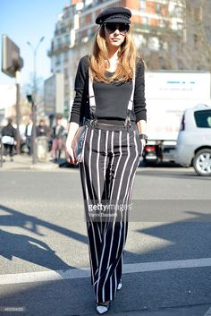 Alexandra Lapp wearing Emilio Pucci pants, St. Laurent clutch and Chanel hat and suspenders at Paris Fashion Week Womenswear FW15