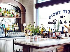 Petit Trois Los Angeles restaurant tour // Marble counter and antique style tin vessels.