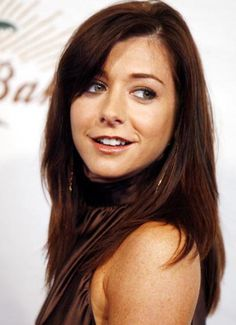 THIS is the hair color I want! A very dark auburn...but too bad I am too pale to pull it off :(