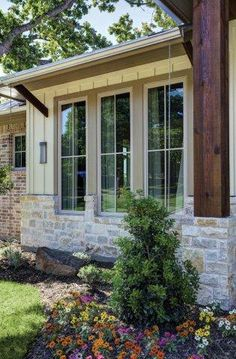 EXTERIOR DINING ROOM WINDOWS: Glazed windows with simple grid pattern.