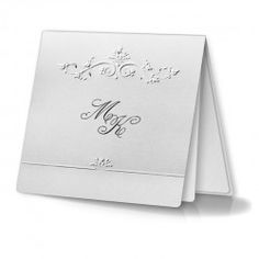 The invitation is made from white pearl paper. The cover is decorated with delicate embossing and silver plating. The initials of the bride and groom are printed on the cover. The insert for printing is made from white, matte paper.  The invitation is made with great care and attention to detail. Precise printing, careful execution, and high quality paper.