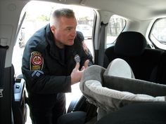 Master Police Officer Wolber inspecting a child seat