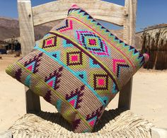kilim pillows: The traditionally handwoven kelim patterns are hand embroidered with a traditional cross stitch technique and modern colorful yarns.