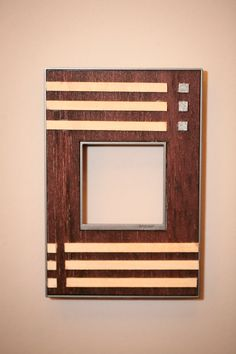 Custom wall plate with unique woodwork #adornebylegrand. Designed by Kyle Brewer.