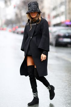 Anna Dello Russo in a fringed hat and a fierce pair of boots. #streetstyle at Paris Fashion Week Fall 2014 #PFW