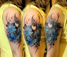 painterly blue flower tattoo by Lukasz Bam Kaczmarek