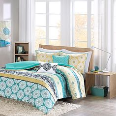 Add fresh bursts of color to your boho chic space with the lively Intelligent Design Arissa Comforter Set. It features bold medallions and geometric designs in yellow and green stripes accented by bursts of navy for added contemporary appeal.