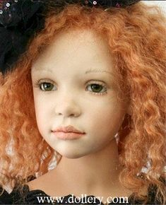 """Zofia Zawieruszynski Collectible Dolls. Gizella, 34"""", LE/10 She has green German glass eyes and carrot red human hair.  She wears a black silk dress and her boots are porcelain."""