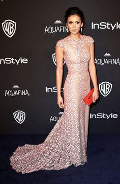 Nina Dobrev chose an ethereal pink gown by Max Azria Atelier, paired with Anne Sisteron jewelry, Yliana Yepez clutch and Gianvito Rossi shoes. See more Golden Globes afterparty looks here!