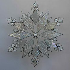 stained glass snowflake suncatcher (design 18) $55 (Etsy)
