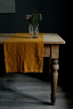 I love the deep mustard color of the table cloth.