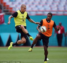 In control: Martin Skrtel holds off Glen Johnson as Liverpool train in Florida ahead of Mo...