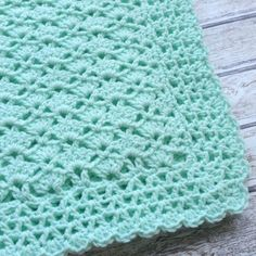 Crochet Mint Green Baby Blanket for boys and girls. Great size for a crib, car seat, or stroller. Makes a wonderful baby shower gift or as a coming home outfit accessory. The blanket measures 31 × 28 & is made from a soft baby yarn. Machine washable and dryable. The blanket is