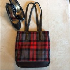Authentic  tartan  coach plaid bag Authentic  tartan  coach plaid is red gray and black beautiful shoulder straps has three compartments and is it center like new condition not used Coach Bags Shoulder Bags