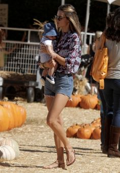 Alessandra Ambrosio and family visit Mr Bones Pumpkin Patch in Los Angeles, CA. During the visit they bump into Jessica Alba with her children and say hello. 10-14-2012