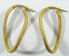 """Lot 195 in the 11.5.13 online & live auction! Lovely 10kt yellow gold hoop style pierced earrings with twisted design. Earrings are accented with textured pattern. Marked """"10k Italy"""", measures: 1.25"""" long. Total weight: .7 dwt. #Jewelry #Fashion #Shopping #POGAuctions"""