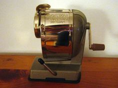 Electric pencil sharpeners are over rated.  I grew up using my grandfather's pencil sharpener, just like this one.  It now belongs to me, and it's one of my favorite things.   It allows the mundane act of sharpening a pencil to come with memories attached.