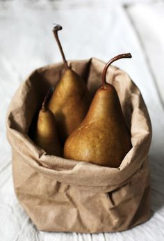 pears in brown paper bag