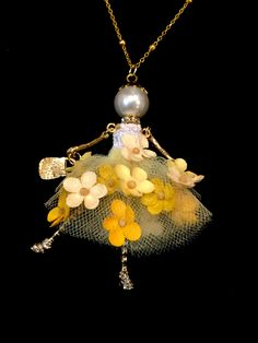 Ellie's Belles: Talulah. French doll pendant necklace with yellow tulle flower skirt.