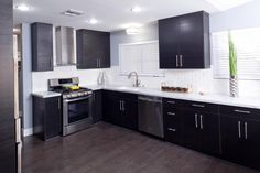 As seen on Brother Vs. Brother, Drew completely changed the layout and look of this kitchen with new cabinets, a beautiful subway tile backsplash and state-of-the-art stainless steel appliances for a look that is totally fresh and modern.