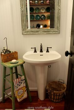 """i love the use of the stool for """"counter"""" and hand towel rack...and the wire trash bin."""