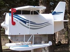 Show off your love of classic planes with this handcrafted wooden Sea Plane. Of course you don't have to be a pilot to get a nostalgic feeling from this retro mailbox. Funny Mailboxes, Unique Mailboxes, Painted Mailboxes, Custom Mailboxes, Mailbox Makeover, Diy Mailbox, Mailbox Ideas, Mailbox Designs, Mailbox Decorating