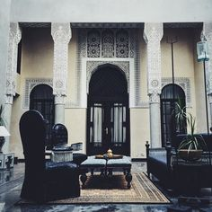 """Riad - definition: """"...a traditional Moroccon house or palace with an interior garden or courtyard."""" In our minds Riad Fes is a perfect example. Such luxury! Squint really hard and you can see a beautiful Leica with one of our Westminster straps on the table."""