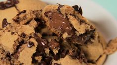 Recipe with video instructions: A secret stash of hidden Nutella takes your cookies to next-level deliciousness. Ingredients: 100g hazelnut flour, 60g flour, 60g of cane sugar, 80g soft salted butter, 1 egg, 1 tablespoon baking powder, 1 large jar of Nutella, 200g chocolate chips