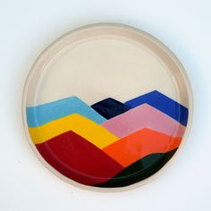 Hand formed and painted stoneware plate. Plate measures approximately 7 inches wide with 1 inch lip.  This item is made to order and will ship in 3-6 weeks.