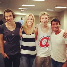Harry and Niall with an interviewer who could also be the mysterious blond