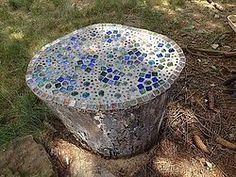 Here is a fun project and a nice side table for your backyard fire pits. I used Mosaic tiles and glass beads from the craft store. It is glued with mosaic tile…