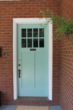 red brick house with teal door - Google Search