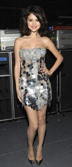 Who made  Selena Gomez's silver strapless dress that she wore to the Justin Timberlake & Friends Concert on October 23, 2010?
