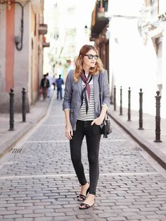 Mireia Oller of My Daily Style in a striped top, blazer, and neck scarf