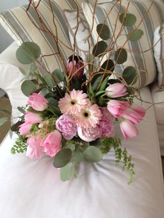 Pink tulips, gerber daisies and peonies.