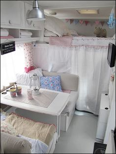 Likey: Upper bunk and curtain hides the driver/passenger seats in this motorhome. We traveled around South America in a converted Pepsi Cola truck made into a motor home like this.
