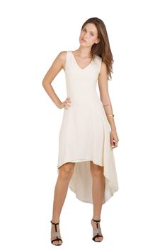 Hello spring! abacaxi allows us all to look forward to the new season with this 100% silk crepe de chine dipped hem maxi dress. #abacaxi #gnossem #dress #cream