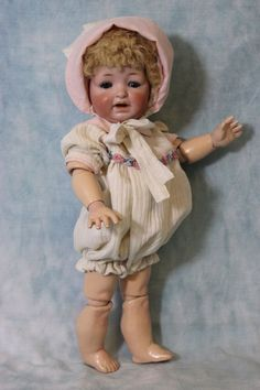 "The body has been professionally repainted in places but it is beautifully done and not very noticeable. The back of the head is marked with ""Made in Germany 5 211 JDK ""Sammy doll"". Turn of the Century Antiques, located on antique row, stood out from the crowd from the beginning. 