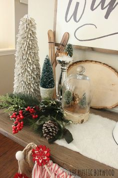 Styling the entry for Christmas | The Rustic Boxwood | faux Christmas greenery, diy ticking garland, cloche, vintage deer, christmas trees, bottle brush trees, skis, faux fur, diy, farmhouse style, entryway decor