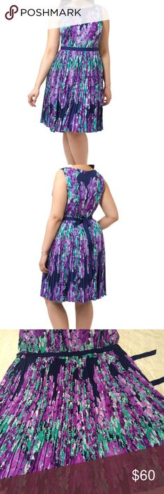 """Adrianna Papell Purple Placed Floral Dress Pre-owned in excellent condition Sleeveless lightweight crepe A-line dress with boat neck, no stretch, pleated full skirt, self-tie belt, concealed back zip, allover floral print, lined. Bust 52"""", waist 46"""", hips 56.5"""", length from shoulders 45"""" Adrianna Papell Dresses Midi"""