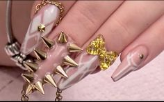 Hi I'm Kirsty Meakin from Naio nails in this video I'm going to show you how to do a design using nude and white and some gold chain. So for this design I've already applied an acrylic nail extension and the shape we're going for today is the ballerina shape. I've also applied the urban graffiti gel polish in the colour birthday suit. Which is a lovely nude colour. Cos' today we're going to be working with nude and white and gold. We're going to use white gel so white hard gel this is. Cos i…