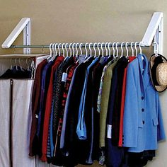 Expand your hanging space outside the closet with QuikCloset Wall-Mounted Garment Rack - gives you 3 to 5 ft of additional hanging storage (warning this is only a good idea if you're super neat!)