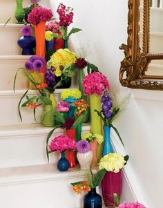 love the idea of assorted coloured vases with coloured flowers... maybe on buffet on entrance? fresh and bright