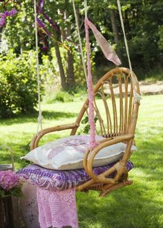Remove the legs from a rattan chair to create a comfy chair swing. (This would definitely be my spot to chill at the end of a day).